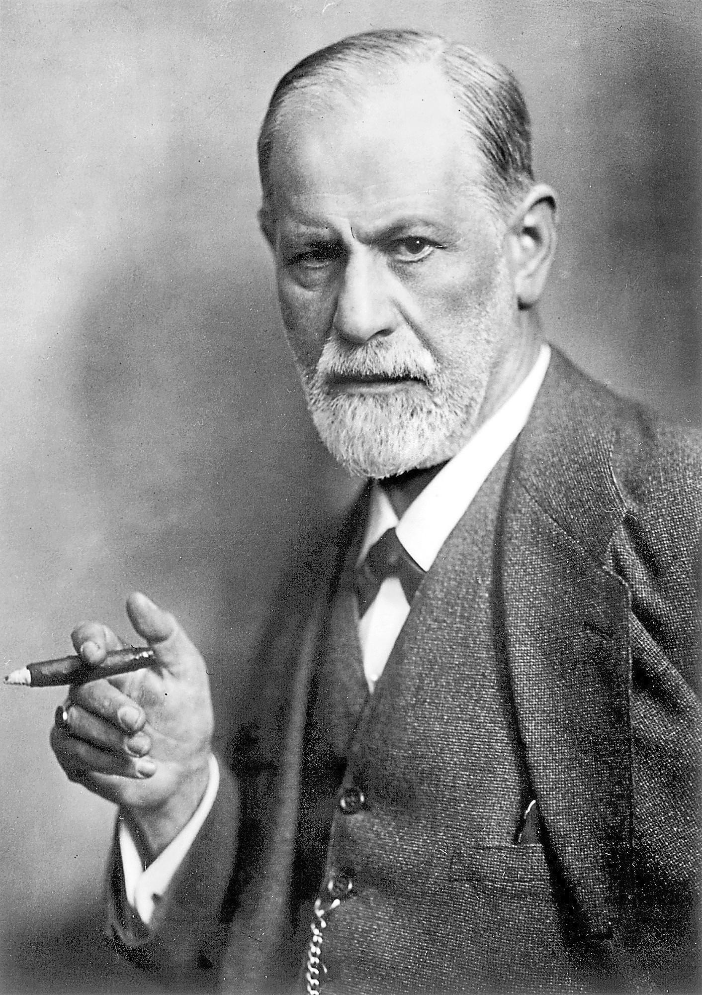 Sigmund Freud s cigaro v roki.